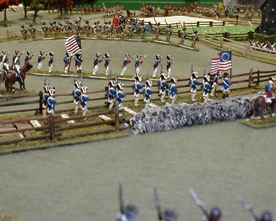 The opening volley is fired as the troops come to firing range.
